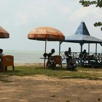 Photo taken at Dampo Awang Beach by Kakak K. on 8/7/2013