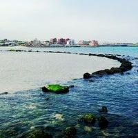 Photo taken at Iho Taewu Beach by SunUk on 6/15/2013