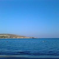 Photo taken at Vouliagmeni Beach by Myss T. on 7/22/2013