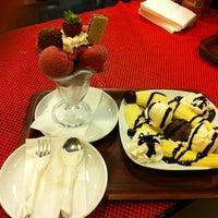 Photo taken at City Cafe & Restaurant by Fatih U. on 6/16/2013
