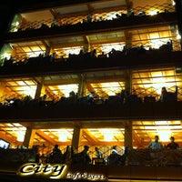 Photo taken at City Cafe & Restaurant by Fatih U. on 7/26/2013