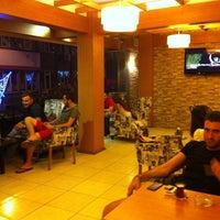 Photo taken at City Cafe & Restaurant by Fatih U. on 7/14/2013