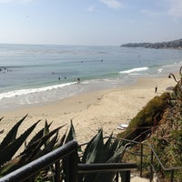 Photo taken at Aliso Beach by Gokkus on 3/17/2013