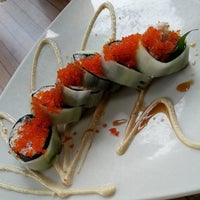 Photo taken at Doraku Sushi by Dennis P. on 6/2/2013