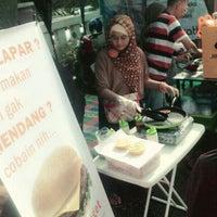 Photo taken at Pasar kaget juanda depok by Fikha S. on 4/20/2014