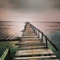 Photo taken at Teluk Tempoyak by Ooi J. on 11/16/2013