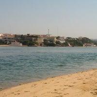 Photo taken at Praia de Vila Nova de Milfontes by Tiago G. on 7/4/2013