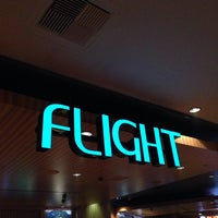 Photo taken at Flight Bar by Masashi S. on 6/20/2014