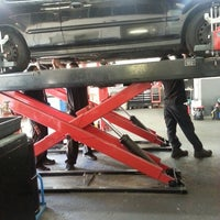 Photo taken at Synkro Automotive Repair Corp. by Sarah L. on 7/25/2013