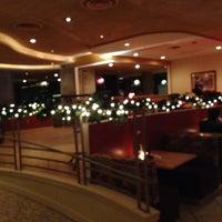 Photo taken at Coast Restaurant by Chris G. on 1/1/2014