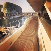 Photo taken at Yas Marina & Yacht Club by Hamad A. on 8/24/2014