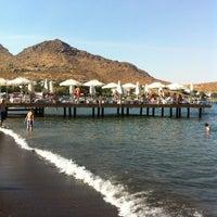 Photo taken at Parıltı Beach by TC Berna A. on 7/26/2013