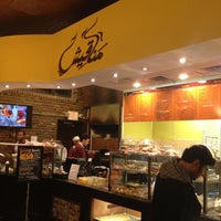Photo taken at Manakeesh Cafe Bakery by Michael C. on 12/27/2012