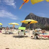 Photo taken at Spiaggia San Vito Lo Capo by Han S. on 4/25/2014