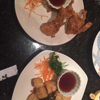 Photo taken at Sakura Asian Fusion Restaurant by Jie B. on 12/30/2015