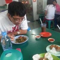 Photo taken at Akhiun Tahu Goreng by Cen W. on 6/22/2013