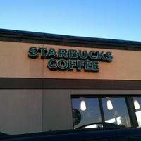 Photo taken at Starbucks by Jacqui S. on 12/19/2012