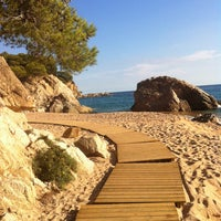 Photo taken at Canyelles Beach by Olena on 10/7/2013