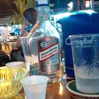 Photo taken at Tiki bar by Jonny G. on 7/26/2014