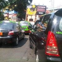 Photo taken at Jalan Suryakencana by Irene D. on 7/8/2013