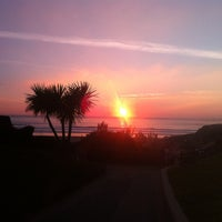 Photo taken at Woolacombe Beach by Sarah T. on 9/23/2013