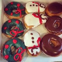 Photo taken at Krispy Kreme by Heather B. on 12/21/2014