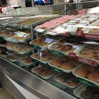 Photo taken at Krispy Kreme Doughnuts by Tass A. on 12/26/2012