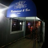 Photo taken at Huskies Restaurant & Bar by Stephen C. on 5/11/2013