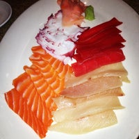 Photo taken at Sushi Zushi by Janelle C. on 5/25/2013