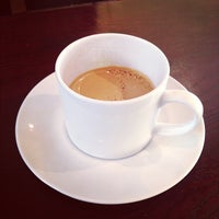 Photo taken at Buchi Cafe Cubano by Ryan E. on 10/31/2012