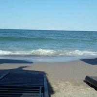 Photo taken at Plaja Neptun by Tudor C. on 7/21/2013