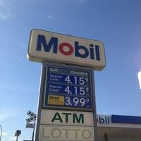Photo taken at Mobil by Joseph V. on 6/4/2013