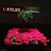 Photo taken at L'Atelier de Joël Robuchon by Lana N. on 6/16/2013