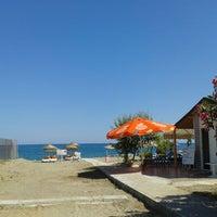 Photo taken at Ünlüselek Beach by Adem N. on 6/22/2013