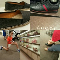 Photo taken at Gucci by UmiAbiNini on 12/18/2015