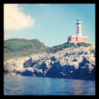 Photo taken at Faro di Punta Carena by Vincenzo A. on 10/6/2012