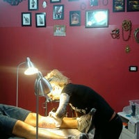 Photo taken at Namaste Tattoo Studio by Michela G. on 6/21/2013