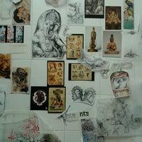 Photo taken at Namaste Tattoo Studio by Michela G. on 8/30/2013