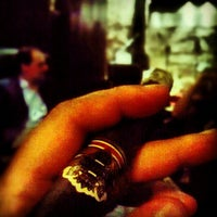 Photo taken at El Clique Cigar Lounge by Grant S. on 10/26/2012