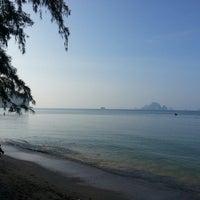Photo taken at Ao Nang Beach by Marina E. on 10/31/2013