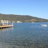 Photo taken at Izer Beach by Esra G. on 8/19/2014