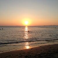 Photo taken at Saronida Beach by Vilka V. on 8/14/2013