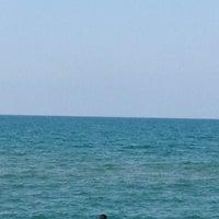Photo taken at Akkum Plajı by Yeliz Y. on 7/13/2013