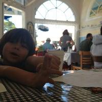 Photo taken at Holly's Lighthouse Cafe by Lenka V. on 5/26/2013