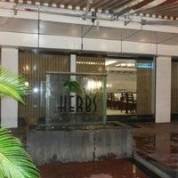 Photo taken at Herbs Cafe & Restaurant by Prasad S. on 5/30/2013