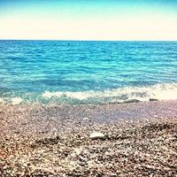Photo taken at Kolymbia Beach by Irina K on 7/27/2013