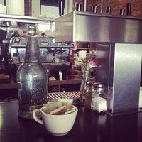 Photo taken at Iris Cafe by Tish V. on 5/5/2013