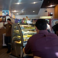 Photo taken at Organic Coffee Co. by Marcelo B. on 10/2/2012