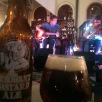 Photo taken at Raglan Road Irish Pub by Abby E. on 7/26/2013