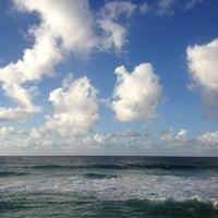 Photo taken at Ehukai Beach by Eric L. on 11/10/2012